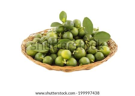 Fresh calamondin on a straw basket isolated in white background. - stock photo