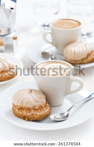 fresh cappuccino and cakes, vertical - stock photo