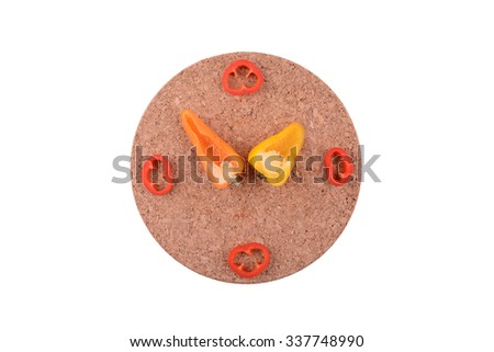 Fresh capsicum arranged as a clock - stock photo