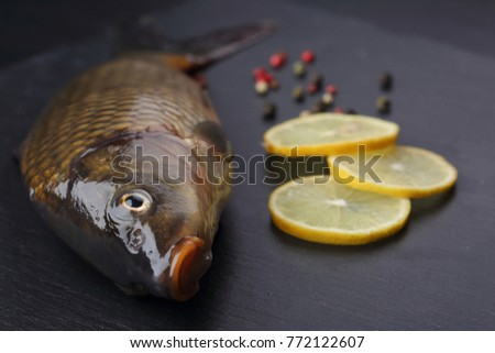 Fresh carp with peppers and lemon. Closeup