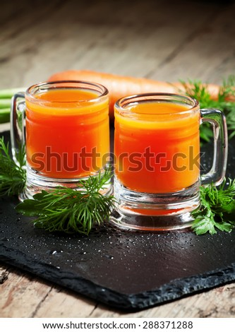 Fresh carrot diet  juice  in old-fashioned glass mug, selective focus - stock photo