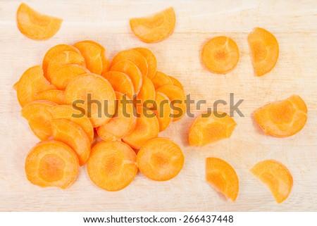 fresh carrot on cutting board - stock photo