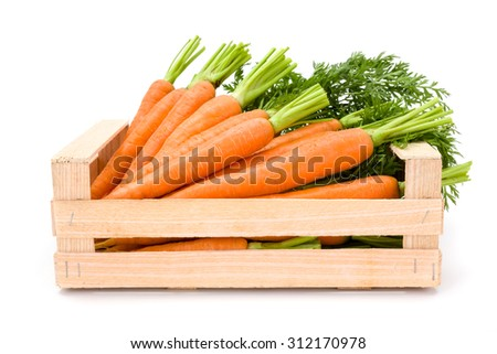 Fresh carrot roots (Daucus carota ssp. sativus) in wooden crate on white - stock photo