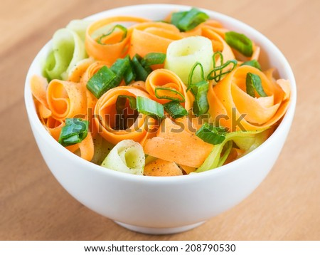 Fresh carrot salad in bowl closeup