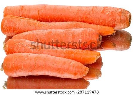 Fresh carrots and reflection isolated on white background - stock photo