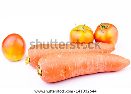 Fresh Carrots and tomatos on isolated - stock photo