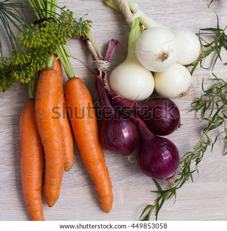 Fresh carrots bunch on rustic wooden background. Red onions on rustic wood. Different onions on wood. White onion on wood. Tarragon - stock photo