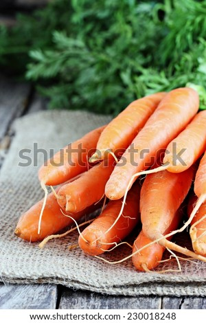 Fresh carrots on a rustic wooden table.Selective focus. - stock photo