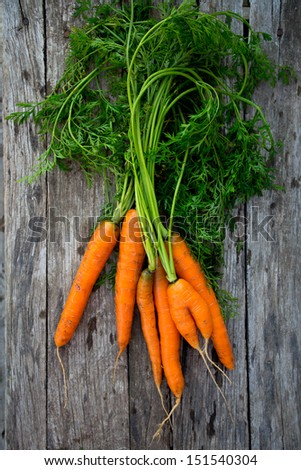 fresh carrots on wooden background - stock photo