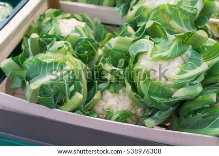 Fresh cauliflower in a box at the weekly market