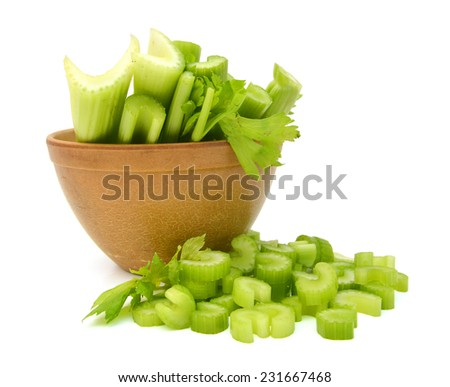fresh celery in wooden bowl on a white background  - stock photo