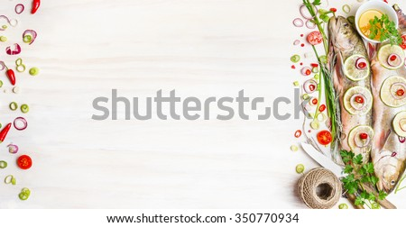 Fresh char fish with herbs, spices and ingredients for tasty cooking on white wooden background, top view, banner.  Healthy food or diet nutrition concept. - stock photo