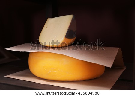 Fresh cheese on the shelf in cellar - stock photo