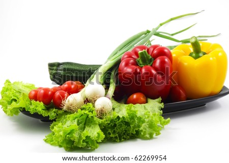 Fresh cheese tomatoes, bell peppers, zuccini, spring onions, lettuce - stock photo