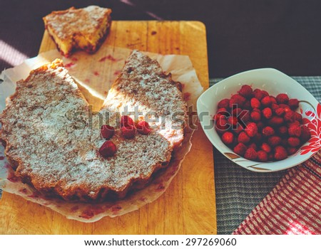 Fresh cheesecake with apple tea sprinkled with powdered sugar as a dessert on the brunch - stock photo