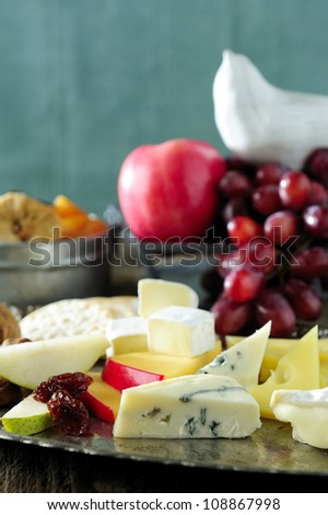 fresh cheeses and fruits for appetizers - stock photo