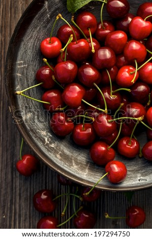 Fresh cherries in a bowl - stock photo