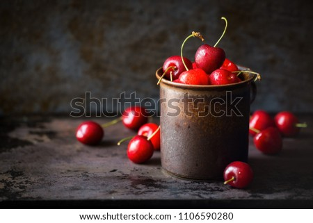 stock-photo-fresh-cherries-in-a-brown-ru