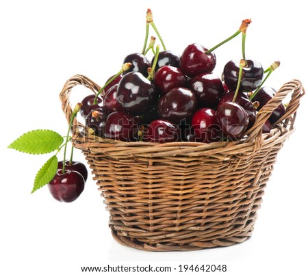 fresh cherries in a wicker basket isolated on white background