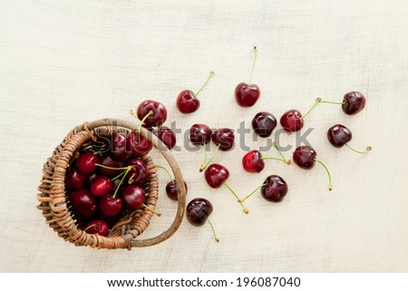 Fresh cherries in the basket - stock photo