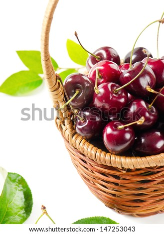Fresh cherries in the basket isolated on white background