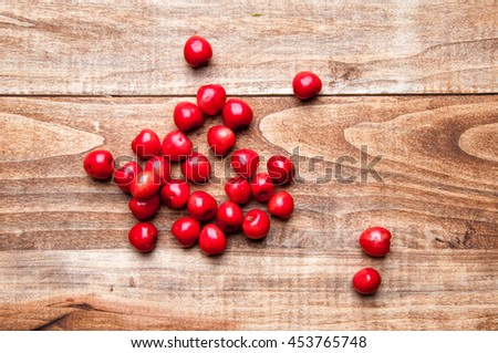 Fresh cherries on a wooden table. - stock photo