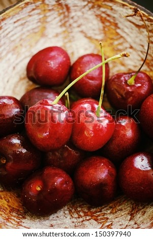 Fresh cherries on the wood background