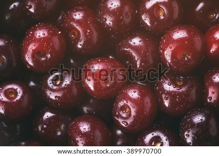 fresh cherries top view background, vintage toned - stock photo