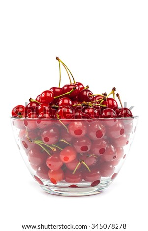 Fresh cherry fruits in a glass bowl isolated on a white background.
