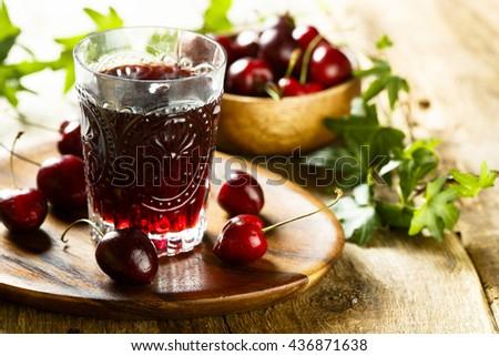 Fresh cherry juice - stock photo