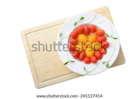 fresh cherry plum tomato on white plate isolated on white background,Healthy eating concept - stock photo
