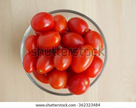 Fresh Cherry Tomato on wooden table topview - stock photo