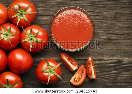Fresh cherry tomato sauce on rustic wooden background