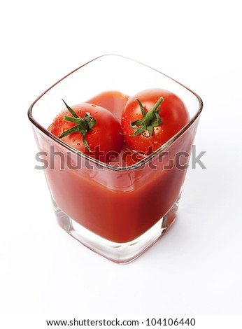 Fresh cherry tomatoes and a glass of tomato juice, isolated on white background - stock photo