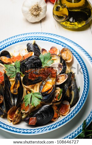 Fresh cherry tomatoes, mussels and clams parsley. Typical Italian Dish