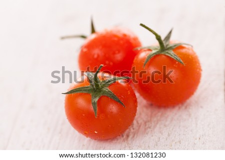 Fresh cherry tomatoes on a white background