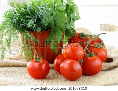 Fresh cherry tomatoes on a wooden board - stock photo