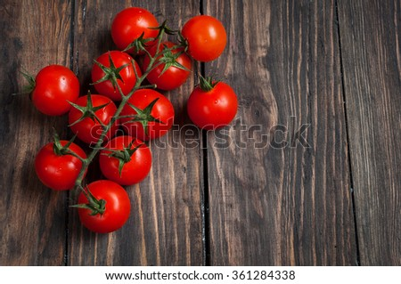 Fresh cherry tomatoes on wood background. Top view - stock photo