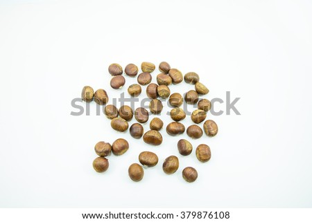 Fresh chestnuts close-up isolated on white background.