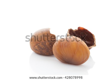 Fresh chestnuts isolated on white - stock photo