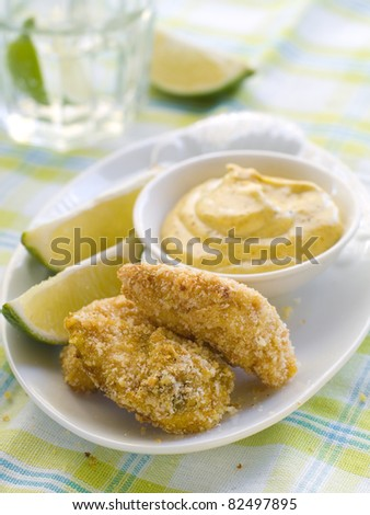 fresh chicken nuggets with mustard sauce. Selective focus - stock photo