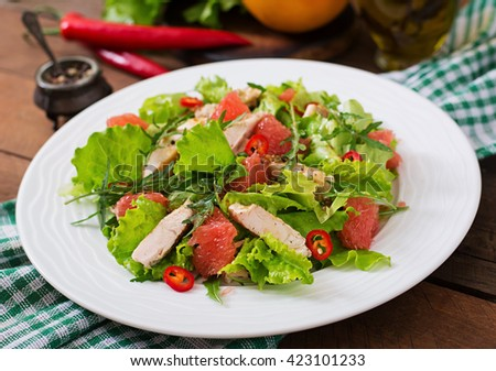 Fresh chicken salad, grapefruit, lettuce and honey mustard dressing. Dietary menu. Proper nutrition.