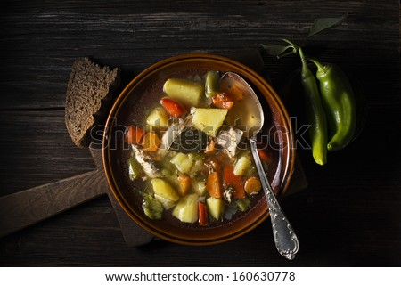 Fresh chicken stew on wooden background overhead shoot - stock photo