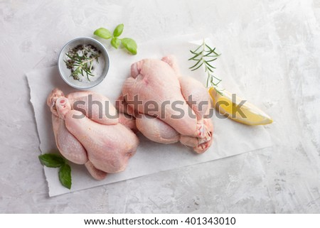 Fresh chicken with spices on vintage background, selective focus. Healthy food, diet or cooking concept  - stock photo