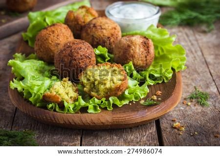 fresh chickpeas falafel  with tzatziki sauce, selective focus - stock photo