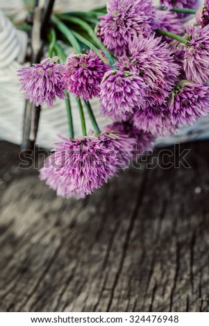 Fresh chives flower over rustic background. Spring or summer floral background - stock photo