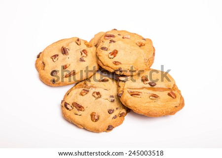 Fresh Chocolate chip and pecan nut cookies - stock photo
