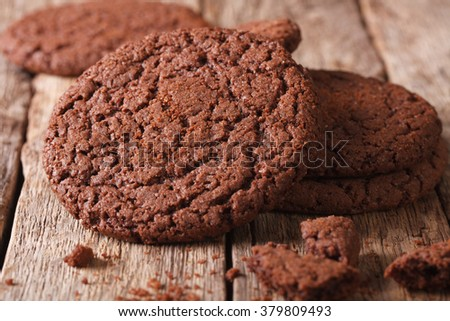 Fresh chocolate cookies with cracks macro on the table. horizontal, rustic
