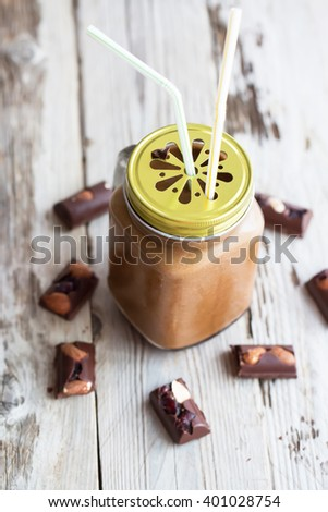 Fresh chocolate smoothie on wooden table. Natural light. Selective focus.  - stock photo