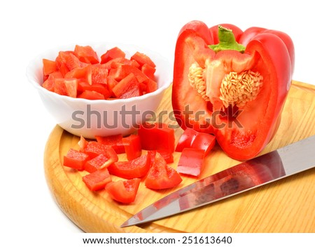 Fresh chopped bell pepper with a knife blade on the cutting board - stock photo